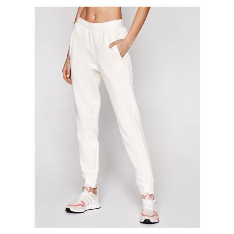 Adidas Spodnie dresowe adicolor 3-Stripes GN3456 Beżowy Slim Fit