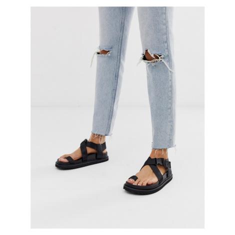ASOS DESIGN Freestyle toe loop sporty sandals in black