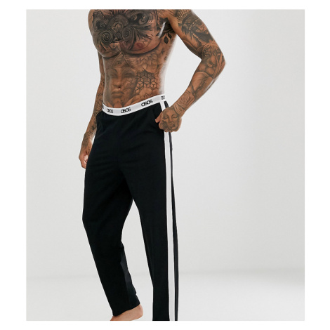 ASOS DESIGN lounge pyjama bottom in black with side stripe and branded waistband